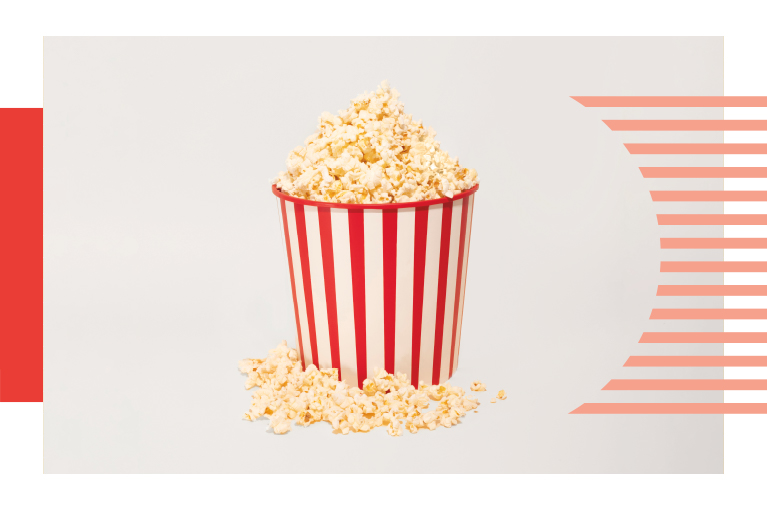 red and white striped bucket overflowing with popcorn